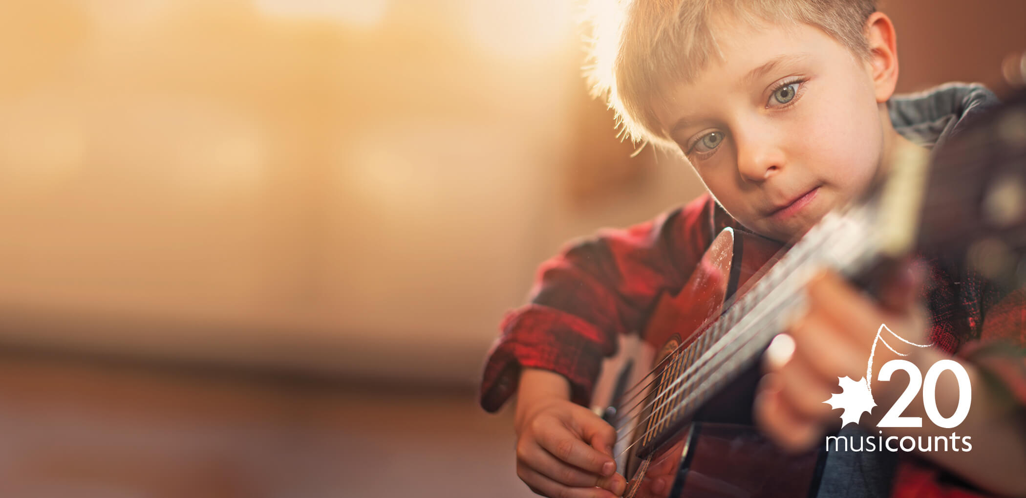 Young boy playing the guitar